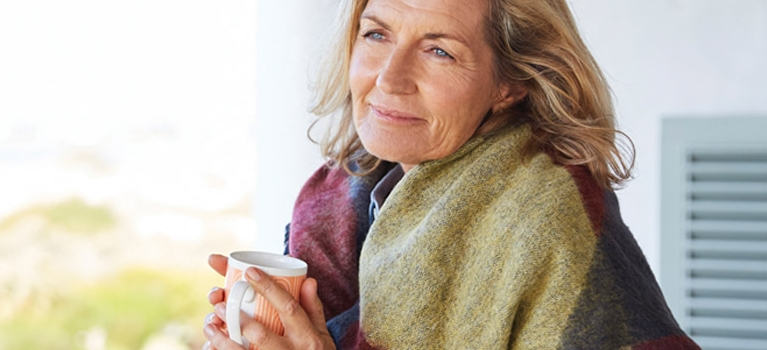 Woman drinking coffee outside