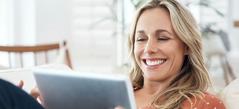 Woman sitting with tablet